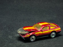 Toy Car With Coins Crammed Und...