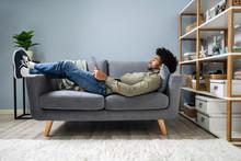 Man Using Digital Tablet On Sofa
