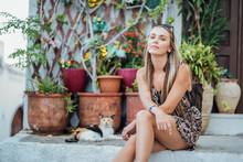 Beautiful Young Woman Sitting ...