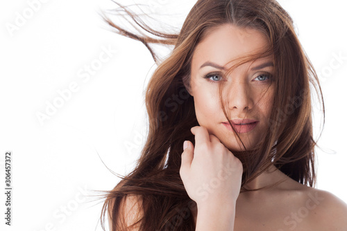 healthy lifestyle and face care. Portrait of a young beautiful woman with with long hair, close-up