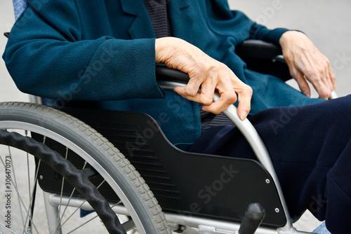 Fototapeta  Elderly woman and wheelchair.