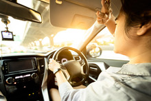 Asian Female Driver Covering Face By Hand Of Bright Sun,disturbed Dazzled By Sun Light,difficulty In Driving,young Woman Driving Car Feeling Hot Uncomfortable,risk Of Eye Damage From Ultraviole,UV Ray