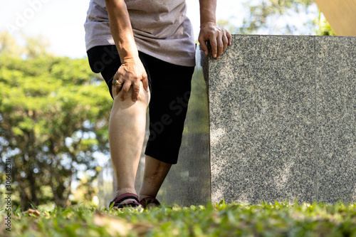 Close-up of legs of injured senior woman have knee pain,swollen knees and hand t Canvas Print