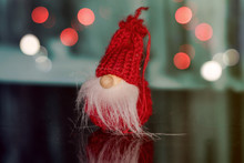 Red Christmas Gnome On An Unfocused Background