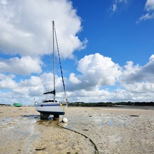 Yacht During Ocean Low Tide In...