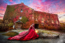 Beautiful Girl In A Burgundy Coat And Red Dress Sitting On The Background Of The Castle In The Park, October