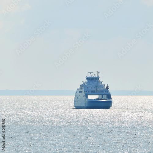 Fotografia, Obraz Doubleside ferry sailing in the bright sunny day