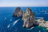 Aerial drone shot view of faraglioni limestone crags in summer time in Tyrrhenian sea off Capri Island
