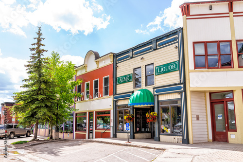 Crested Butte, USA - June 21, 2019: Colorado colorful village stores in downtown in summer with vintage mountain architecture and liquor