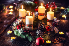 Advent Wreath With Four White Burning Candles Christmas Ball And Decorations On A Wooden Background With Festive Atmosphere