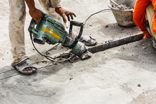 Construction Worker Using Jack...