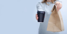 Woman Holding Cardboard Cup Of...