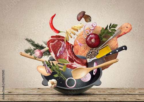 Poster de jardin Akt Big red pot with meat and vegetables