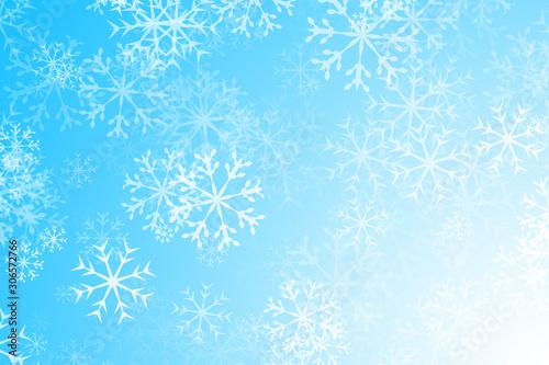 Fotografía Fondo azul navideño con copos de nieve.