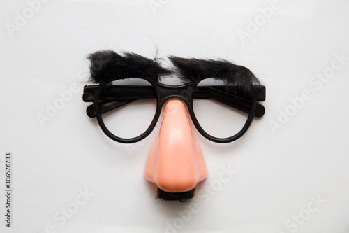 Fotografie, Tablou  Closeup of a fake nose and glasses, with furry eyebrows
