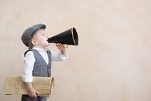 Child Shouting Through Vintage Megaphone