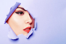 Beautiful Face Of A Girl, Professional Makeup, Arrows, Long Eyelashes, Large Lips. Blue Background. Beauty Salon, Personal Care. Fashion Photo