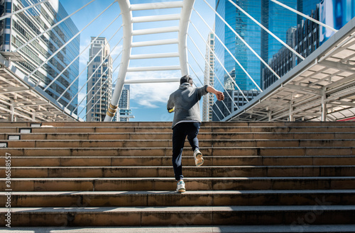 People running ahead on the stair, hope yourself to a better life and take yourself there.