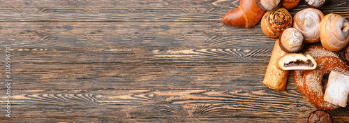 Heap of tasty pastries on wooden background