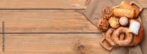 Fotografie, Obraz Board with tasty pastries on wooden background
