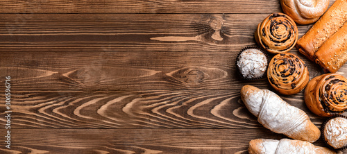 Fototapeta Tasty pastries on wooden background