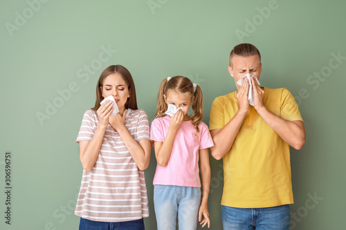 Photo Family suffering from allergy on color background