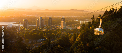 Obraz Cable car in Portland, Oregon, USA with wonderful view on sunrise with mt. Hood and aerial tram going to OHSU - fototapety do salonu