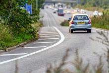 Car Moving Towards Uk Motorway...
