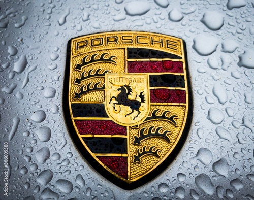 Fotografia, Obraz  Porsche Logo Badge Crest Hood Ornament Closeup in the Rain