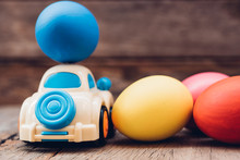 Easter Egg And Toy Car On Wood...