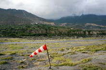 Striped Windsock At A Local Small Airfield Amid The Himalayan Mountains In Jomsom, Nepal.