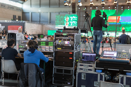 Canvas Lighting and Sound Technicians and Television Operators at Work in the BackStage