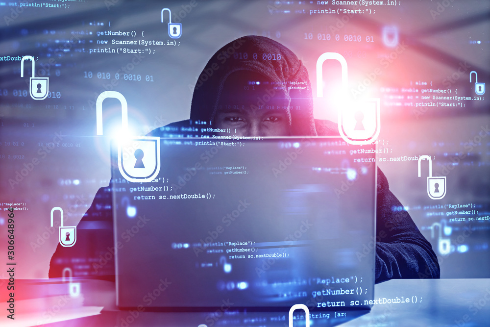 Fototapeta Young hacker with laptop in office, cyber security