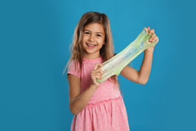 Little Girl With Slime On Blue...