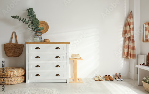 Foto Chest of drawers in stylish room interior