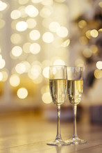 Two Glasses Of Champagne With Lights In The Background. Focus On Near Glass.
