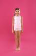 Leinwandbild Motiv Cute little girl in underwear on pink background
