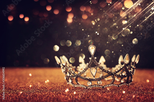 Fototapeta low key image of beautiful queen/king crown over gold glitter table