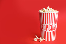 Tasty Pop Corn On Red Backgrou...