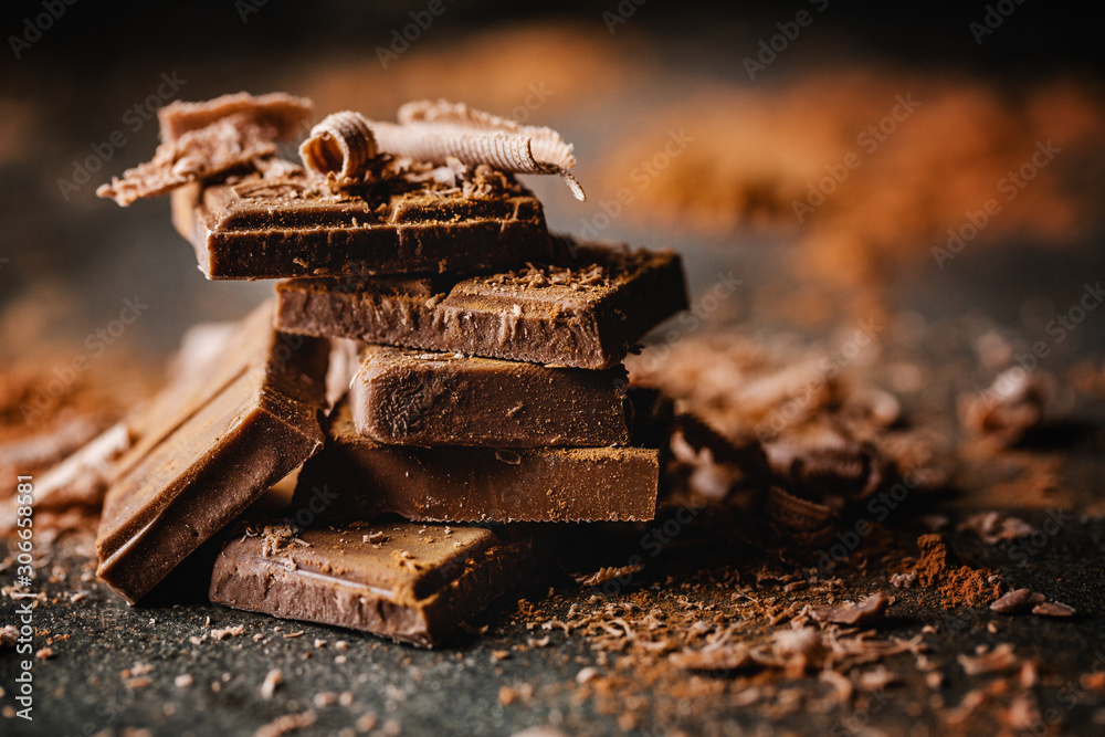 Fototapeta Dark chocolate on dark background