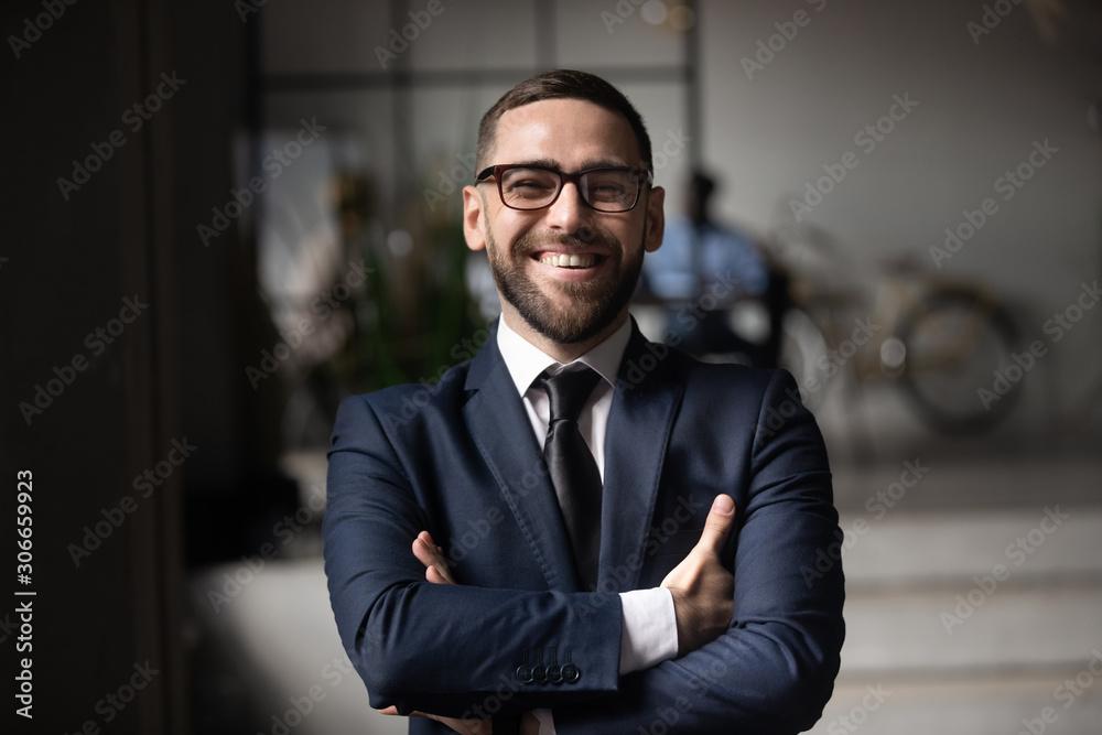 Fototapeta Head shot close up portrait of happy businessman.
