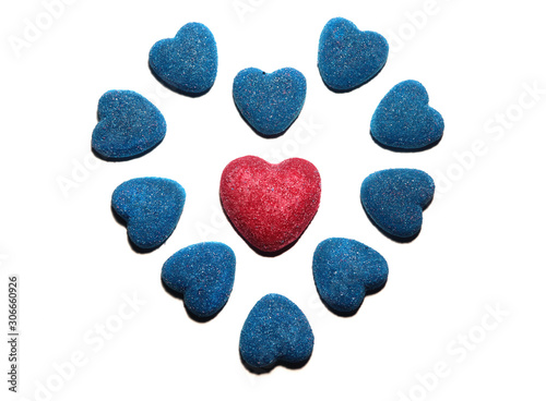Heart-shaped bright blue chewing marmalade sprinkled with crystal sugar in the middle of which is a pink heart isolated on a white background Canvas Print