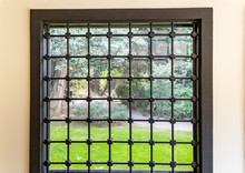 Iron Barred Home Glass Window ...
