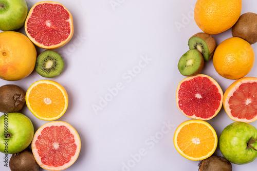 Photo Slice of Grapefruit Orage Kiwi on Blue Background Fruit Background Frame Copy Sp