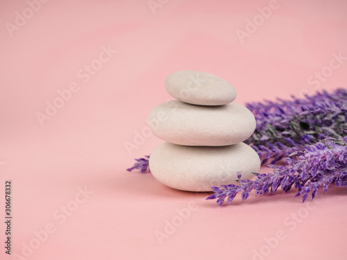 Fototapety, obrazy: Stack of Zen stones on abstract pink background. Relax still Life with folded stones. Zen pebbles, stones, Spa-calm scenes to slow life. with vegetation, ecological concept
