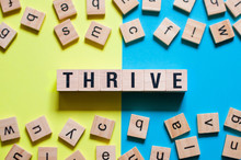 Thrive Word Concept On Cubes