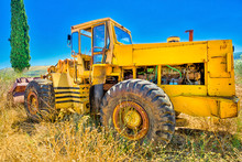 Side View Of An Yellow Tractor...