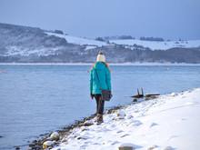 Woman Walking On A Rocky Snow ...