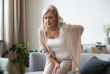 Elderly 60s Woman Suffer From Back Ache