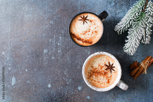 Fototapeta Two cups of coffee with crema, cinnamon and badian on dark background obraz